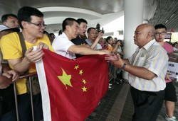 Chinese Activists Return Amid Japan