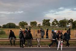 Migrants Break Through Police Line